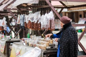 Hanging above are churchkhela, a traditional goodie made of nuts and wine